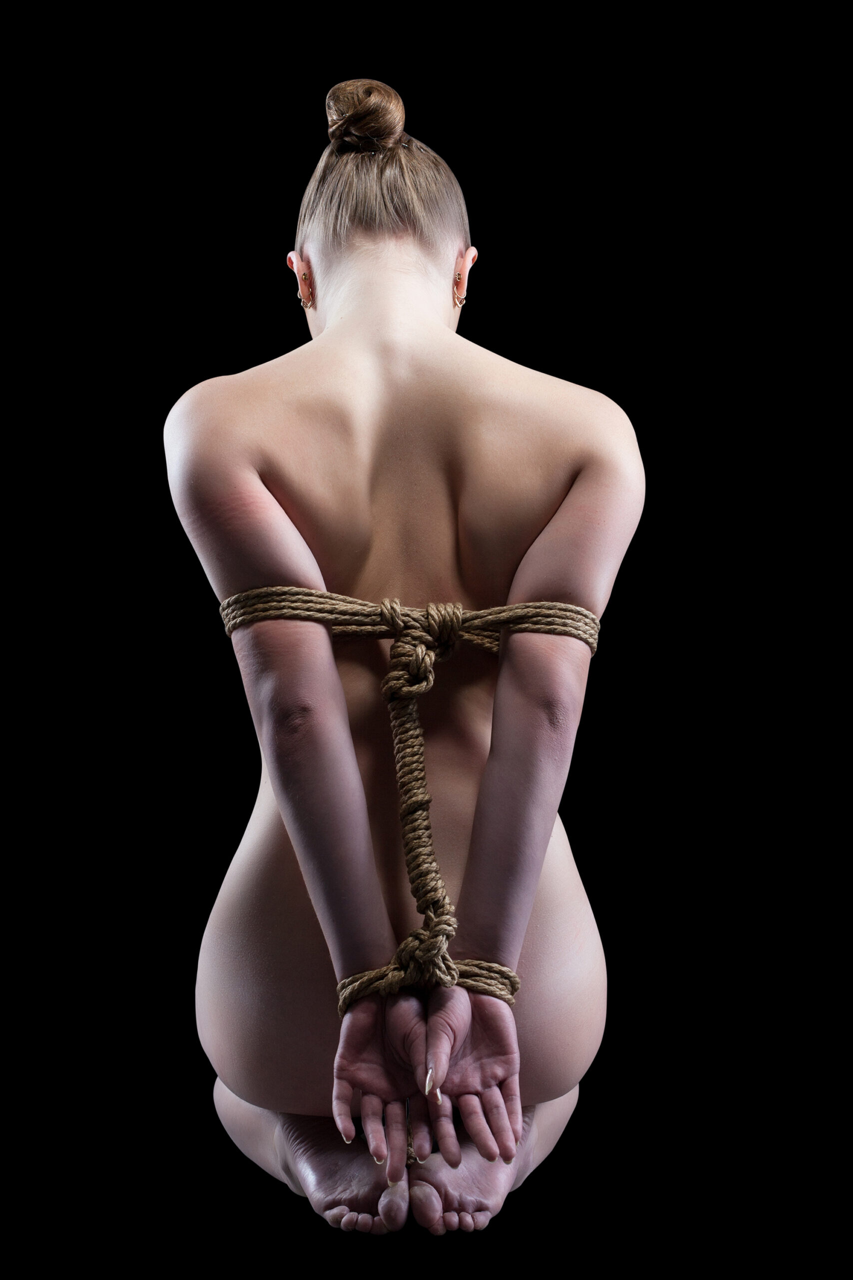 Sensual Bondage With Arms Bound Behind Her Back
